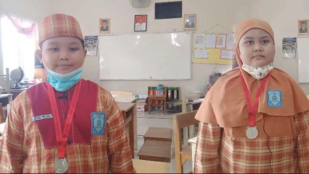 M. Octara Pratama Putra dan Anindya Nur Fadillah, Siswa dan Siswi SD Muhammadiyah 12 Surabaya, Meraih Silver Medal di Matematical Olympiad Hongkong 2021